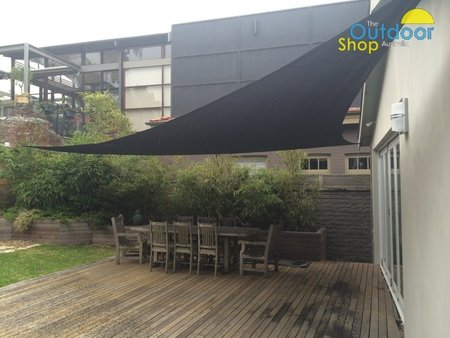 Picture showing one of our larger Right Angle Triangle 90 degree shade sail in black. Shade sail has been fixed to a sandstone rock with a 100mx100m wall plate.\\n\\n21/10/2014 9:14 PM